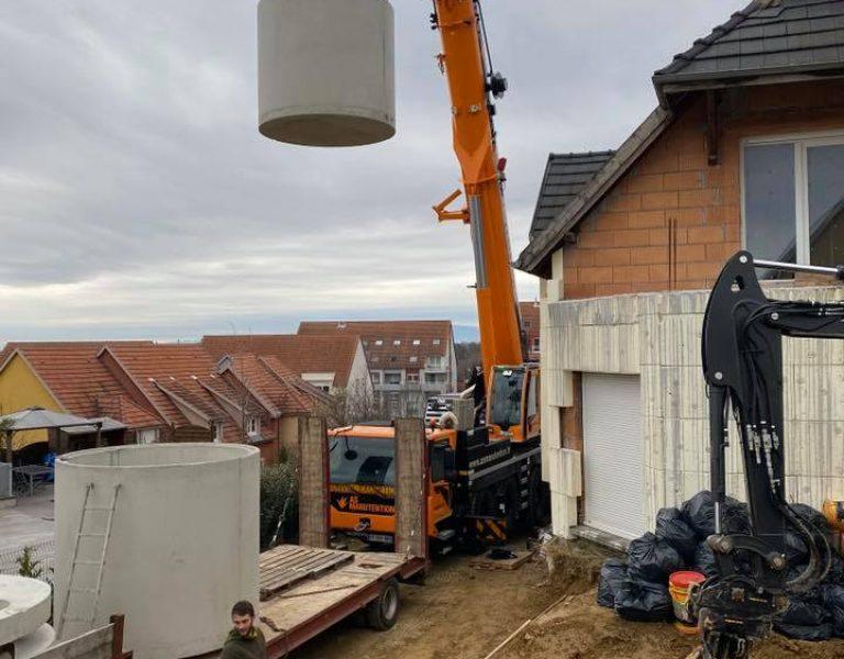 Mise en place cuve de récupération d'eau de pluie